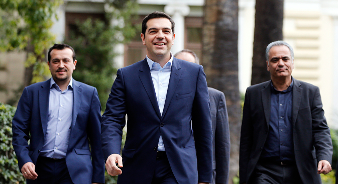 Greece's newly-appointed Prime Minister Alexis Tsipras (C) leaves the Presidential Mansion after his swearing-in ceremony as Greece's first leftist prime minister in Athens January 26, 2015. Source: Reuters