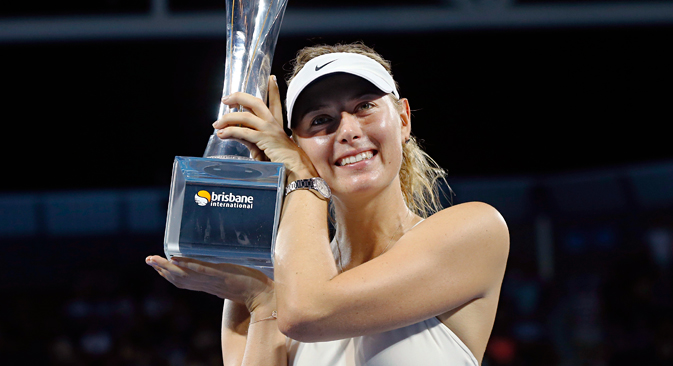 Maria Sharapova holds the Brisbane International tennis tournament women's singles trophy after defeating Ana Ivanovic of Serbia in Brisbane, January 10, 2015. Source: Reuters