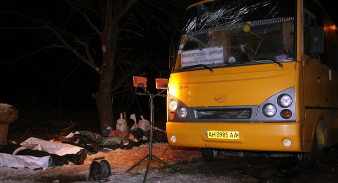 A damaged passenger bus near Volnovakha after it was hit by a shell. Several people were killed. Source: Valentin Sprinchak / TASS