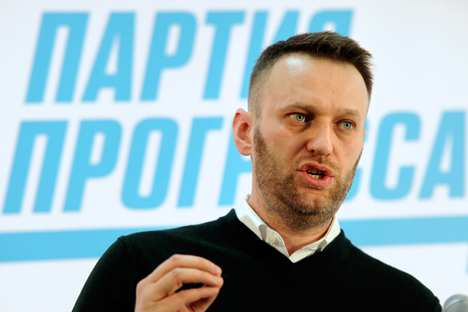 Russian opposition activist and anti-corruption crusader Alexei Navalny addresses his party members in Moscow, Russia, Sunday, Feb. 1, 2015. Letters in Cyrillic at the background read: Party of Progress. Source: AP