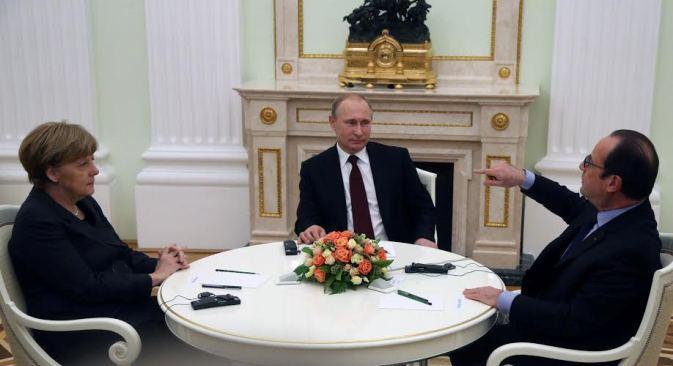 Die Bundeskanzlerin Angela Merkel, Russlands Präsident Wladimir Putin und der französische Präsident François Hollande während des Treffens in Moskau am 6. Februar 2015.  Foto: Konstantin Sawraschin/Rossijskaja Gaseta