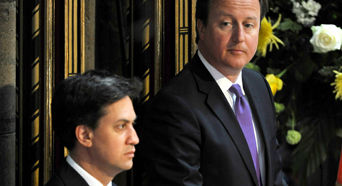 Both British PM David Cameron (r) and challenger Ed Miliband (l) are tough on their stance toward Russia. Source: AP