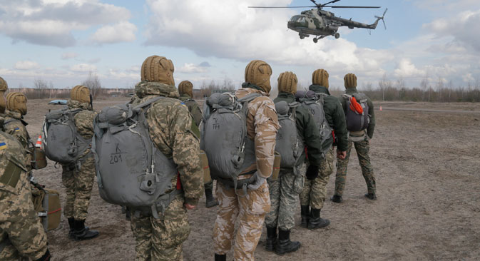 Ukrainian army soldiers perform a military exercise at a training ground outside Zhitomir, Ukraine, on March 6. Source: AP