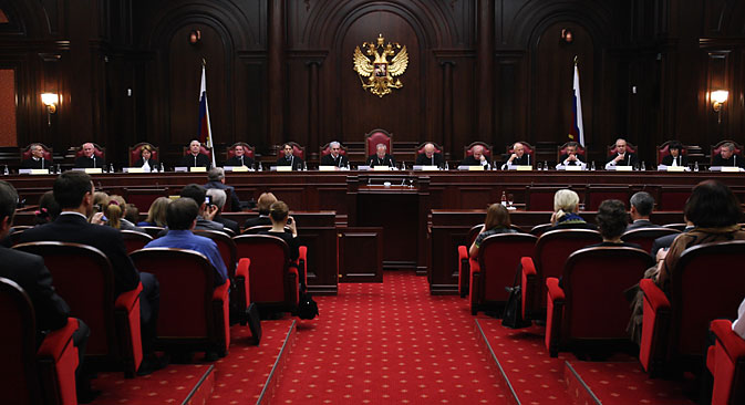 The deportation of HIV-positive foreign nationals who have families in Russia is unlawful, the Constitutional Court ruled on March 16. Source: Alexei Danichev / RIA Novosti