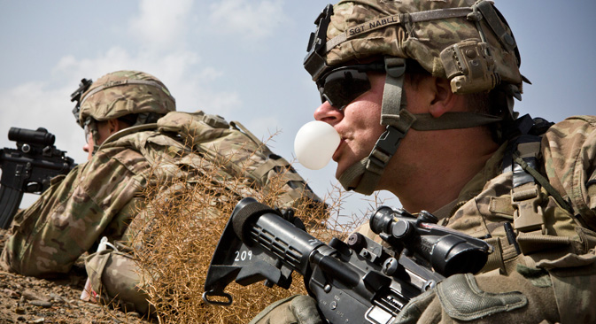 A U.S. Army soldier with Charlie Company, 36th Infantry Regiment, 1st Armored Division blows a bubble with his chewing gum during a mission near Command Outpost Pa'in Kalay in Maiwand District, Kandahar Province, 2013. Source: Reuters