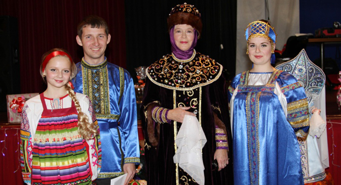 Russian community members in national costumes. Source: Edinenie