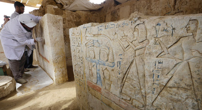 An Egyptian conservator cleans limestones at a newly-discovered tomb dating back to around 1100 B.C. at the Saqqara archaeological site, 19 miles south of Cairo, Egypt. Source: AP