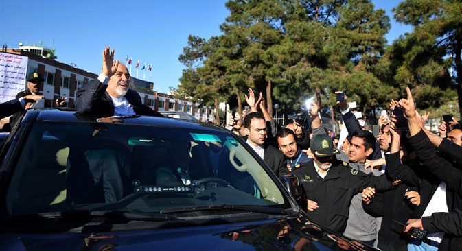 Iranian Foreign Minister Mohammad Javad Zarif, who is also Iran's top nuclear negotiator, waves to his well wishers upon arrival at the Mehrabad airport in Tehran, Iran, from Lausanne, Switzerland, Friday, April 3, 2015.  Source: AP