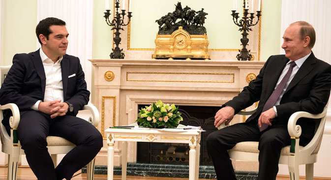 Greek Prime Minister Alexis Tsipras (L) and Vladimir Putin during a meeting in Moscow. Source: Press photo