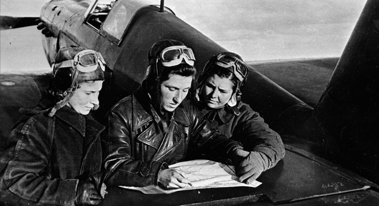 Aces of 586 the 586th Fighter Aviation Regiment (L-R): Lilya Litvyak, Katya Budanova, Masha Kuznetsova near the Yak-1 fighter. Source: RIA Novosti