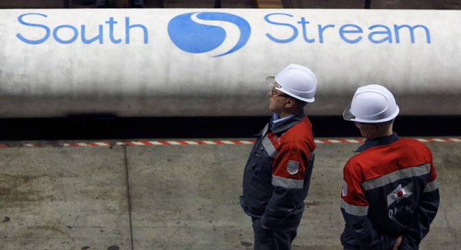 Employees stand near pipes made for the South Stream pipeline. Source: Reuters