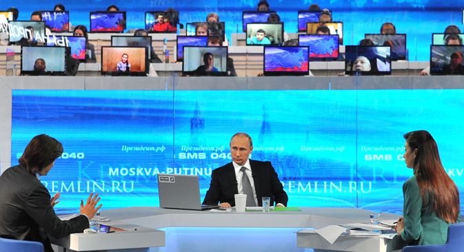 Vladimir Putin spent more than four hours answering questions from the public on various issues in the annual broadcast. Source: EPA