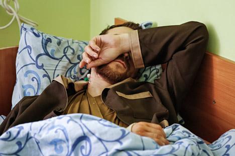 Yevgeny Yerofeyev lies on a bed at a hospital in Kiev, Ukraine, May 19, 2015.