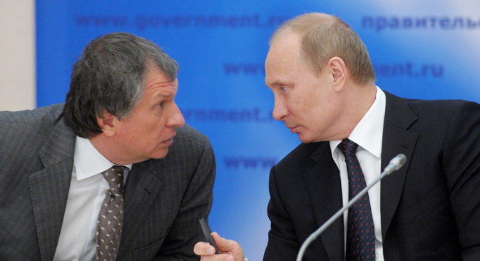 Rosneft's head Igor Sechin and President Vladimir Putin. Source: AP