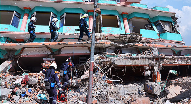 Rescue workers of the Russian emergency situations ministry clearing debris in the aftermath of a 7.8-magnitude earthquake that struck Nepal on April 25, 2015. Alexei Shtokal/TASS