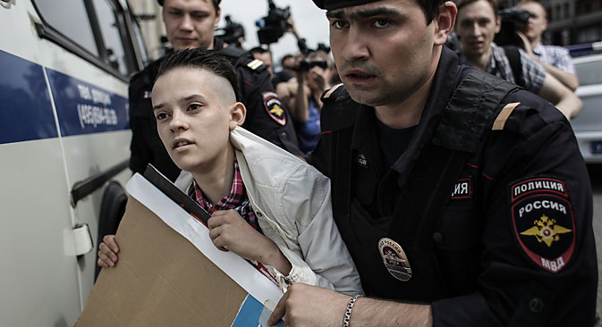 Police apprehend a participant of an unauthorized rally held by gay activists outside the building of the Russian parliament in Moscow, 2013. Source: Andrei Stenin / RIA Novosti