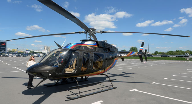 A Bell 407 GX helicopter by Moscow's Crocus Expo exhibition hall before the HeliRussia 2015 expo. Source:  Mikhail Voskresenskiy / RIA Novosti