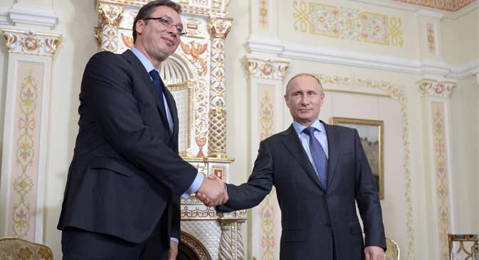 Serbia's prime minister Aleksandar Vucic and Russia's president Vladimir Putin shake hands during their meeting at Novo-Ogaryovo residence, July 8, 2014. Source: Alexei Nikolsky / TASS