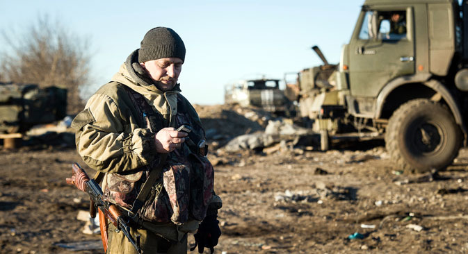 A soldier from the rebel forces of the self-proclaimed Donetsk People's Republic takes a break in Debaltsevo, near Donetsk, on Feb. 24. Source:EPA / Vostockphoto