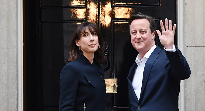 David Cameron, pictured here with his wife Samantha outside No. 10 Downing Street in London, has won a second term as British Prime Minister. Source: EPA