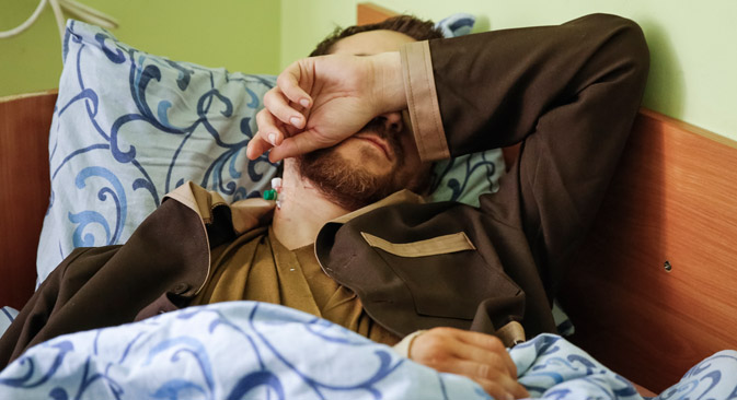Yevgeny Yerofeyev lies on a bed at a hospital in Kiev, Ukraine, 19 May 2015. Ukraine claims that Yerofeyev is one of two Russian soldiers captured in eastern Ukraine. Source: EPA