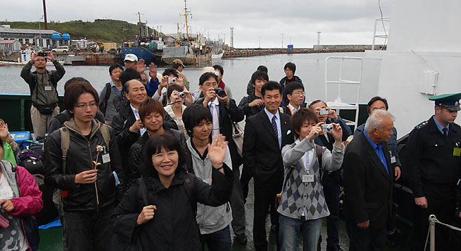 Japanese tourists traveling by ferry to Kunashir, the most populous of the Kuril Islands. Source: Andrey Shapran