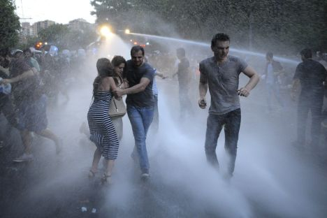 Armenian police use water cannons to disperse protesters demonstrating against an increase in electricity prices in the Armenian capital of Yerevan, Tuesday, June 23, 2015. Source: Narek Aleksanyan/PAN Photo via AP