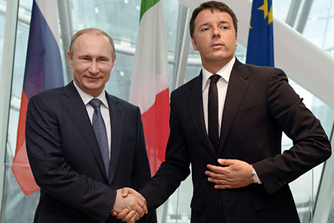 Italian Premier Matteo Renzi with Russian President Vladimir Putin at the end of a press conference at the Expo 2015 in Milan, June 10, 2015.