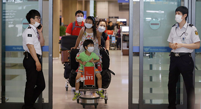 Medical officers will screen passengers coming into the Russian Far East. Source: AP