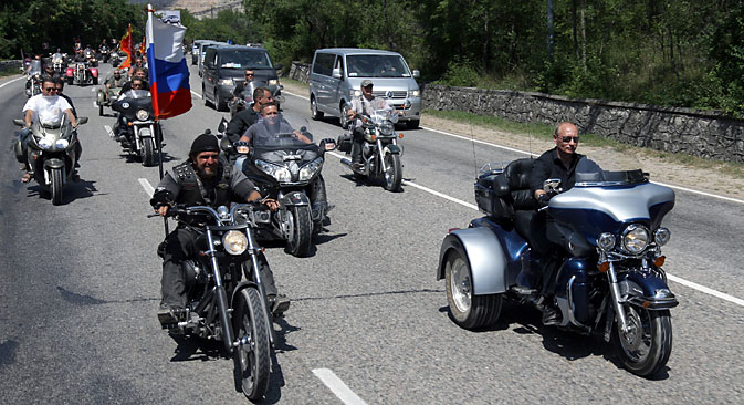 "Moscow's Night Wolves motorbike club president Alexander Zaldostanov, aka ""The Surgeon"" (left), Vladimir Putin attending the motorbike show outside Sevastopol, on July 24, 2010. Source:  Alexei Druzhinin / RIA Novosti"