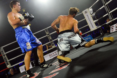 Russian Fedor Chudinov (L) in a fight with Australian Ben Mcculloch. Source: Vladimir Astapkovich / RIA Novosti