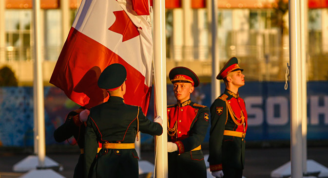 Russian soldiers raise Canada's national flag during a welcoming ceremony for the team in the Athletes Village, at the Olympic Park ahead of the 2014 Winter Olympic Games in Sochi February 5, 2014. Source: Reuters