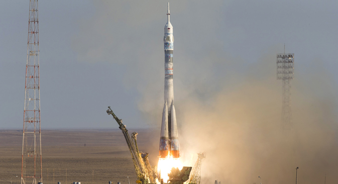 Soyuz-FG rocket booster and Soyuz TMA-11M spaceship launch carrying the Olympic torch on board, at the Baikonur Cosmodrome in Kazakhstan, November 7, 2013. Source: Photoshot / Vostockphoto