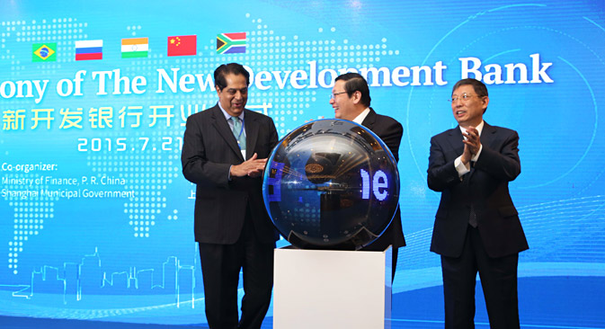 (From left) K.V. Kamath, president of the New Development Bank, Chinese Finance Minister Lou Jiwei and Shanghai Mayor Yang Xiong attend the opening ceremony of the New Development Bank in Shanghai, China, 21 July 2015. Source: AP