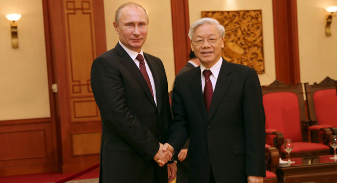 Russian President Vladimir Putin (L) meets with General Secretary of the Communist Party of Vietnam Nguyen Phu Trong in Hanoi, capital of Vietnam.Source: AP