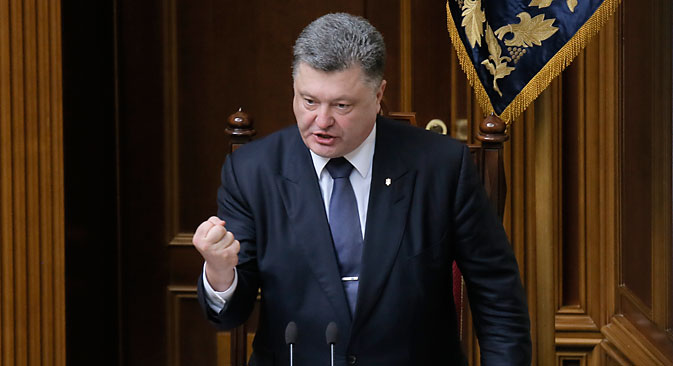 Ukrainian President Petro Poroshenko gestures as he speaks to lawmakers during a parliament session in Kiev, July 16, 2015. Source: AP