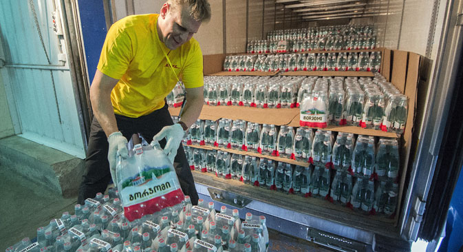 A storage area employee unloading a shipment of Borzhomi mineral water at Mamontovsky Customs Post, outside Moscow, 2013. Source:  Maksim Blinov / RIA Novosti