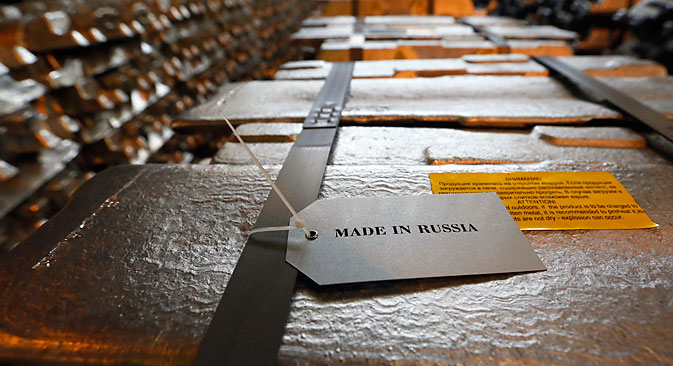"Aluminium ingots with the sign ""Made in Russia"" are stored at the foundry shop of the Rusal Krasnoyarsk aluminium smelter in the Siberian city of Krasnoyarsk. Source: Ilya Naymushin / Reuters"