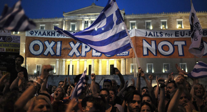 "Supporters of the ""NO"" option for July 5 referendum demonstrate in central Syntagma Square in front of the Greek parliament building in Athens, Greece, June 29, 2015.. Source: EPA / Fotis Plegas G"