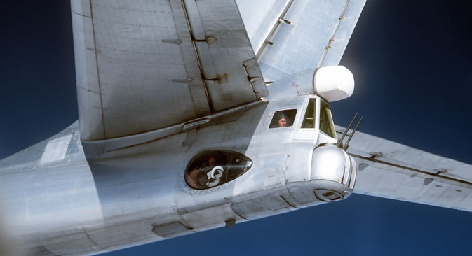 A radio-gunner in the Tu-95 Bear strategic bomber cockpit, photographed from an F4D Phantom fighter of the U.S. Air Force, 1980. Source:  USAF