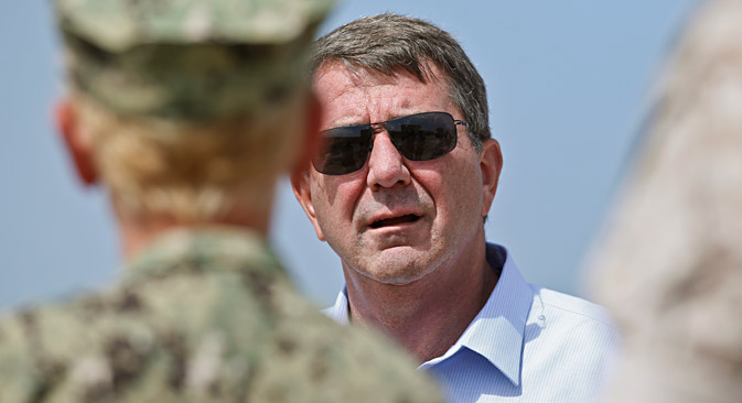 Secretary of Defense Ashton Carter is briefed about a Marine exercise by Marine Major Quint Harris at Red Beach Thursday, Aug. 27, 2015, at Camp Pendleton, Calif. Source: AP