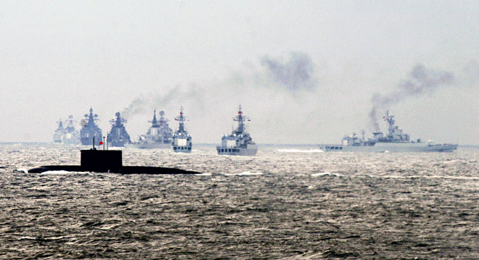 A Chinese warship fires missiles during a China-Russia joint military exercise off China's Shandong Peninsula. Source: Reuters