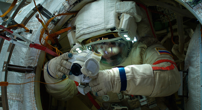 Taking a photo during a mission in open space outside the ISS. Source: Reuters