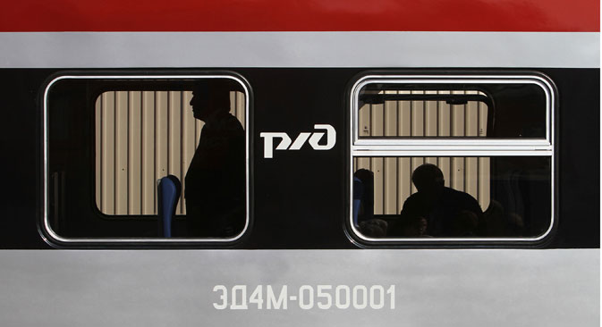 Visitors inspect the interior of an OAO Russian Railways locomotive displayed at the III International Rail Salon Expo 1520 in Scherbinka, Moscow region. Source: Getty Images