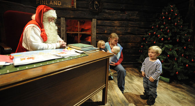 "Santa Claus listens to childrens' wish lists', in his ""office"" in Rovaniemi, Finland. Source: AFP / East News"
