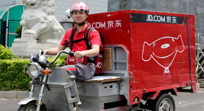 Richard Liu, CEO and founder of China's e-commerce company JD.com, rides an electric tricycle as he leaves a delivery station to deliver goods for customers to celebrate the anniversary of the founding of the company, in Beijing. Source: Reuters