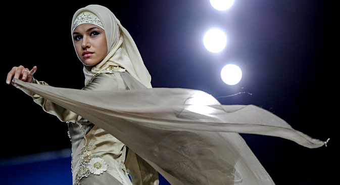 Model showing clothes from the collection Lady Firdaws by fashion house Firdaws, founded by the spouse of the Chechen leader Medni Kadyrova and designer Zarimy Yahaeva as part of Volvo-Fashion Week. Source: Vladimir Astapkovich / RIA Novosti