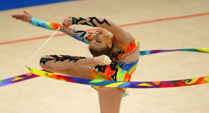 Alina Kabayeva performs with the ribbon during her routine in the team competition at the European Rhythmic Gymnastics Championship in Kiev, June 5, 2004.