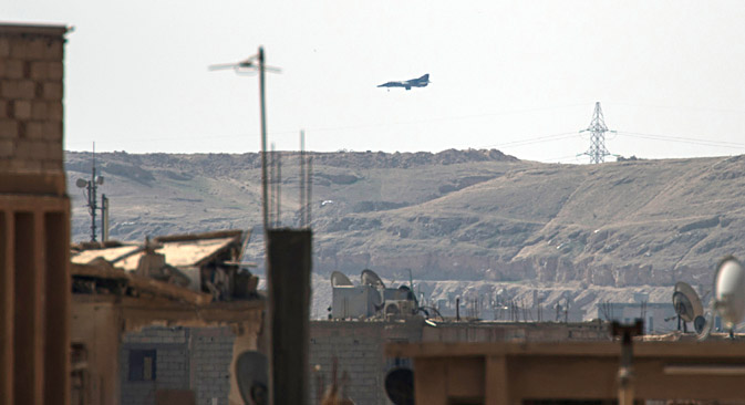 A MiG plane lands to resupply in the Hawiqah neighbourhood in the eastern Syrian town of Deir Ezzor on February 26, 2013. Source: AFP / East News