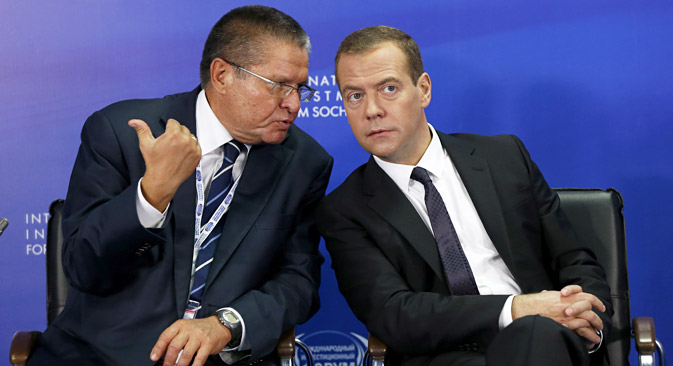 Russian Prime Minister Dmitry Medvedev (right) and Minister of Economic Development of the Russian Federation Alexey Ulyukayev (left) at the Sochi International Economic Forum. Source: Dmitry Astakhov / RIA Novosti